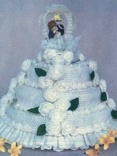 Wedding or Anniversary CakeThis lovely crocheted wedding cake makes a great centerpiece for bridal showers or anniversary celebrations! Crocheted in baby yarn with sizes E and G crochet hooks. Skill Level: Beginner Designed by Joyce Byers free pdf
