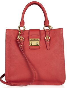 The best red, white, and blue handbags for the 4th of July. Miu Miu Madras Textured-Leather Tote