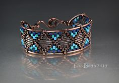 This piece is hand woven in copper with glass seed beads for accents.  I used a very heavy gauge wire for the outside edge which adds a lot of strength to the bracelet.