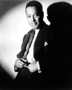 """Duke Ellington 1899-1974 Composer, pianist Left: circa 1925 """"A lifetime of splendor. Duke always stuck to what he knew: a strong, confident look with lots of double-breasted, wide-lapeled suits and overcoats. The best-dressed jazz musician of all time, in my opinion. This is timeless style—you could wear anything Duke wore right now and look amazing."""""""