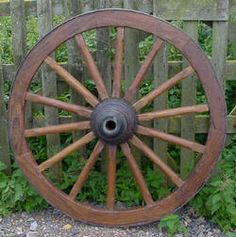 Old wagon wheels will add a nice western feel. Keep a look out for these....