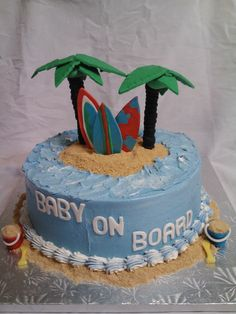 Surfer Boy Baby Shower - This was designed to match the baby shower invitations.  The cake is white velvet and vanilla IMBC.  All decorations are fondant, gumpaste, and modeling chocolate.  The sand is graham cracker crumbs.