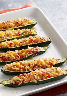Stuffed Zucchini Boats – Deliciously smart zucchini boats get stuffed with basil, fresh tomatoes, buttery crackers, and cheese. Talk about a fun, Healthy Living, family-friendly recipe!