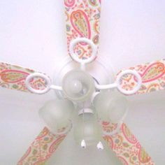 Modge Podge your ceiling fan with scrapbook paper!  We have two plain white ceiling fans that I wasn't in love with but I could do this and make them fun!