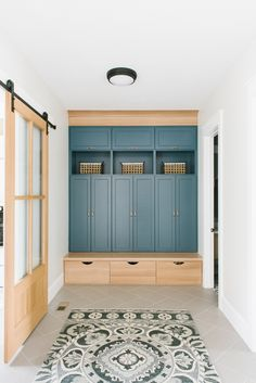 Mudroom Cabinets Newburyport Blue by Benjamin Moore The mudroom carries the same color from the kitchen on the main lockers, but the base of the lockers are a natural white oak Mudroom Cabinets, Mudroom Laundry Room, Laundry Room Layouts, New Home Designs, Home Remodeling, Family Room, Benjamin Moore, White Oak, New Homes