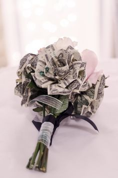 Money flowers for a throw bouquet so the girls get super excited about catching it!  Designed by @Linda Neumann