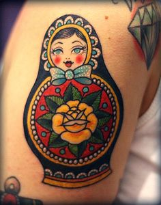 Russian Matryoshka tattoo. Love the face on this one.