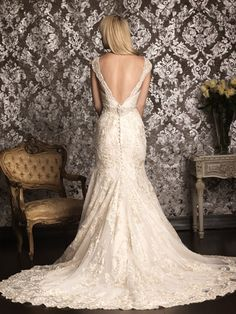 Love the low V-cut back on this lace fit and flair with a vintage edge.  Allure Bridals available at Weddings by Paulette Pinned from www.dreamweddingspa.com