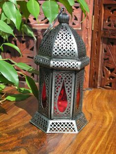 Iron lantern with blue glass Blue Lantern, Lantern Lamp, Lanterns, Moroccan Lamp, Red Glass, Soft Furnishings, Wrought Iron, Pottery, Outdoor Decor