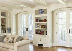 Instead of bookshelves, we can have chimney there, in between the french doors.