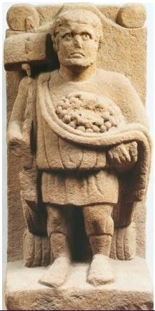 The picture shows the Celtic god as he is usually depicted, with a sledge (or long-shafted hammer), grapes and barrels. Roman villa nearTrier