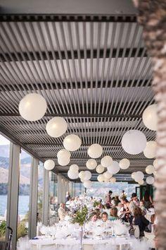 Stylish venue decoration by John's flowers for the wedding of Eleni and Spirogrigoris . #Katavothres club restaurant  photo by nikiforosphotography