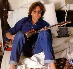 Lennon with red strat 1974