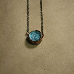A necklace designed with a step bezel & chain. The step bezel is handmade.  Length is 17 long