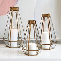 Faceted Lanterns @ West Elm. You could DIY a similar version - just make sure if it's made of something other than metal you don't put it above the flame.