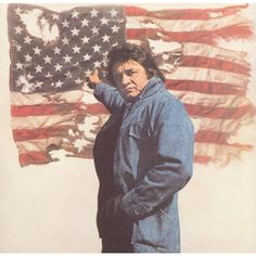 """Hugh Morton's famous image of Johnny Cash holding aloft the American flag. --NC, 1974 * Johnny Cash -- """"Ragged Old Flag"""" The Johnny CashShow --""""This Land is Your Land"""", 1969 read more. Johnny Cash, Johnny And June, I Love America, God Bless America, America America, American Pride, American Flag, American Quotes, American Freedom"""