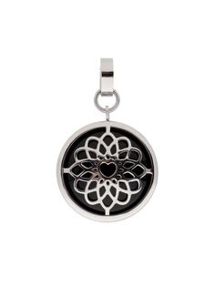 """Mystical or classic pendant """"Paz"""" by Sofia Bobone is wearable on both sides: one side featuring a silver-tone glowing ornament, the other a cabochon polished onyx."""