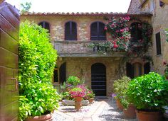 A lovely brick & stone house and garden in Montefollonico, Italy. Photo credit: Silvia Lunazzi