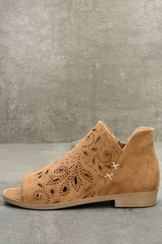 """Our love for all things Boho and the Coolway Nelia Cognac Suede Leather Cutout Peep-Toe Booties knows no bounds! Soft, genuine suede starts at a peep-toe, and carries into a cutout vamp and notched collar. 3"""" exposed zipper at the outstep. Available in European sizes, 36-41."""