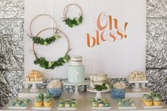 This dessert table for a baby boy's christening is elegantly sparse and gorgeously decorated.