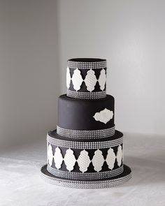 Black, White & Silver Cake. I dont like the little white waffle thingies but I would want some white in it. I like the monogram on the front