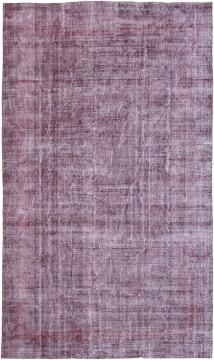Over-dyed rugs and distressed vintage rugs from the Woven Accents gallery can add an aged or ethereal quality to a room design.