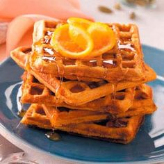 Sweet Potato Waffles spiced with cardamon.  Nutritional Facts  2 (TWO) waffles equals 554 calories, 34 g fat (14 g saturated fat), 185 mg cholesterol, 507 mg sodium, 48 g carbohydrate, 4 g fiber, 13 g protein.