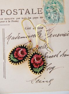Vintage hand stitched petite point pink rose earrings.