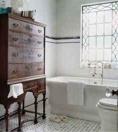 fabulous vintage bathroom....love the antique dresser for storage.   #white #bathroom