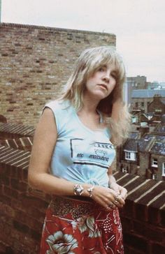 """golddustsoul: """"Stevie photographed in 1976. (had to remove a pesky watermark hence why it's blurry on her Obie's shirt) """""""