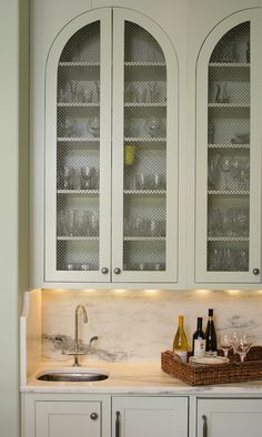 stainless steel mesh cabinet faces show off dishware. - kitchens