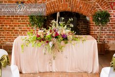 Boho flower displays in rustic wedding, barn  wedding.