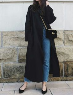 pair an overcoat with some jeans and minimal flats for a cozy look