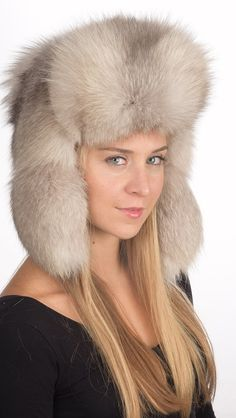 For those women wishing to be trendy and flaunt their own style even in cold winter. This -Russian style- grey fox fur hat is stylish, fluffy, warm and very high quality. Fur on both sides of the front and ear flaps. Each of our fox fur hats is handmade in Italy. We ensure best quality materials. Made in Italy. www.amifur.com