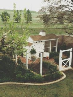 I love the little fenced in area.....but   that is the most beautiful chicken coop I have ever seen!!!!