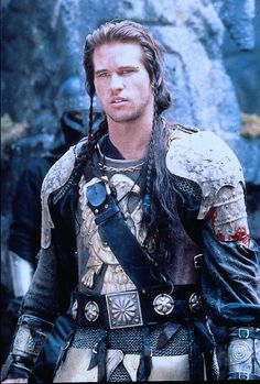 Val Kilmer as Madmartigan in Willow. He was funny in this one, did good action adventure acting also.