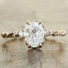 A twisted band gives this engagement ring a natural, rustic feel (the oval diamond would work in any setting, any time, any place)