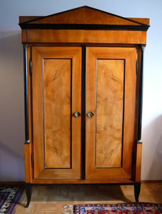 Google Image Result for http://furnituremedicrestorations.com/yahoo_site_admin/assets/images/bigstockphoto_Biedermeier_cabinet_783499.24793200_std.jpg