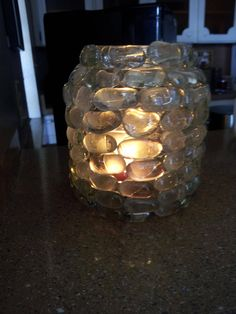I turned an  pickle jar into a nice candle vase!