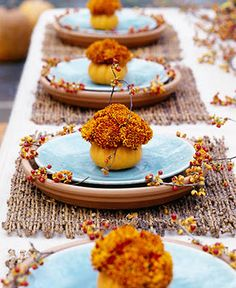 """Centerpiece Inspiration - Take orange flowers (roses, mums, lilies, ?), remove leaves from stems, bunch tight, tie with ribbon, display in blue glass tea holders or use small orange or white """"pumpkins"""" as bases for blue hurricanes and tea lights"""
