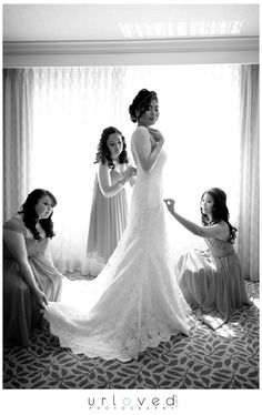 Bride getting ready shot with bridesmaids!