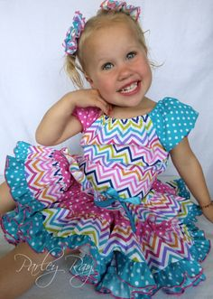 Looking for a Birthday Theme? This one just screams Happy Birthday!!! This is perfect for your little princess! Its so bright & cheery. Great for a little birthday girl! My little Parley loves this outfit! Its just so colorful & fun!  This one is an attention getter! Its just gorgeous! I love it! This is made with lots of fabric! It is fuller than a complete circle! It really twirls! Its so fun for little dancing girls!  The top just slips over the head & ties in the back. This is...