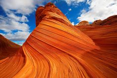 """The Wave"" : Coyote Buttes North Area of Paria Canyon-Vermilion Cliffs Wilderness Area  -- multicolored carved sandstone looks like it was taken out of of Dr. Seuss's Oh the Places You'll Go"