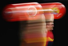 Spain's Andres Eduardo Mata Perez lifts during the men's 77kg weightlifting contest.