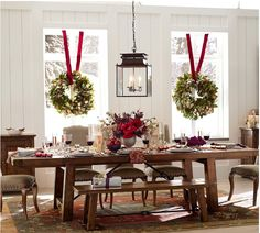 hanging wreaths with thick red ribbon
