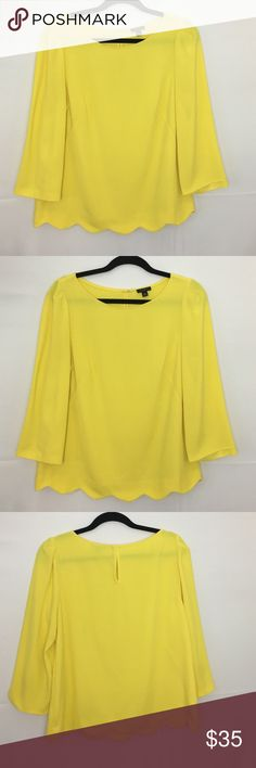 Ann Taylor yellow blouse Ann Taylor yellow blouse. 63% polyester, 33% Rayon, and 4% spandex. Top is best worn with a camisole. Top is in excellent condition Ann Taylor Tops Blouses