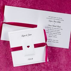 Paneled Heart wedding invitations This bright white invitation features a die-cut heart on the front with two slots to thread the ribbon through to pass behind the heart.