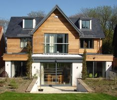 Visit our inspirational timber cladding gallery, with extensive pictures of real domestic and commercial projects using our cedar, Siberian larch and Thermowood exterior cladding. Wood Cladding Exterior, Larch Cladding, House Cladding, Facade House, Dormer Bungalow, Dormer House, Gable House, Cedar Homes, House Extensions