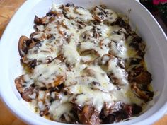 MUSHROOM MOZZARELLA BAKE - I would sauté them in white wine and maybe throw in some onions - gives it such a wonderful flavor.