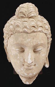A Gandhara stucco head of Buddha -  4th 5th Century